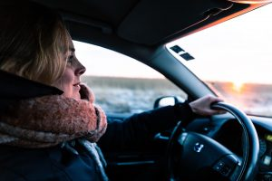 work-related road risk - woman driving a car
