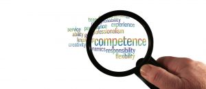 Magnifying glass with word Competence to illustrate blog by Danum Business Solutions, Heath and Safety Consultant