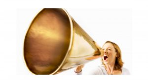 woman shouting through large gold megaphone to illustrate blog how loud is too loud